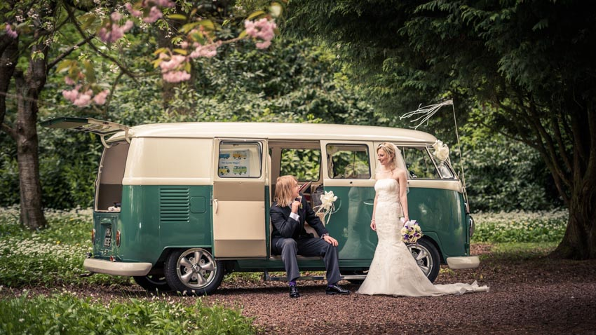 Gloucestershire Wedding Photographer Simon Young's photograph of Jess and Jamie at Eastwood Park next to a Spilt screen campervan.